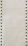 连续的孔打印机标签被猛击的小条  免版税库存照片