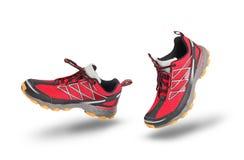 连续红色体育鞋子 免版税库存照片