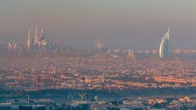 迪拜在日出期间的小游艇船坞和卓美亚奢华酒店集团海滩与清早雾timelapse在迪拜,阿拉伯联合酋长国 股票视频