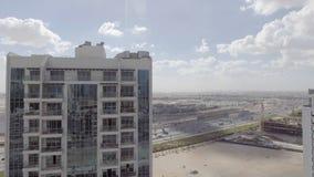迪拜,阿拉伯联合酋长国- 2016年12月:街市迪拜的鸟瞰图太阳的 免版税图库摄影
