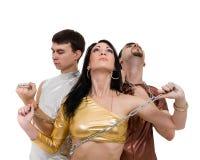 迪斯科舞蹈家队跳舞,在全长的白色 免版税库存照片