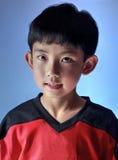 迷人的亚裔男孩 库存图片