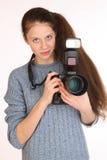 迷人的女孩摄影师 免版税图库摄影