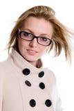 迷人的女孩纵向外套的有流的头发的 库存照片