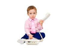 迷人的男孩谈话在电话 免版税图库摄影