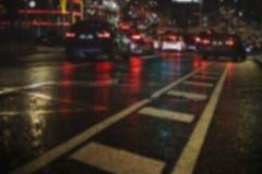 迷离在城市道路的夜交通 免版税库存图片