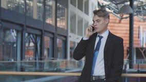 迷离生意人作用行动电话联系 免版税库存图片