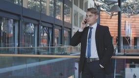 迷离生意人作用行动电话联系 免版税图库摄影