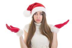 迷茫的少年圣诞老人女孩 库存照片