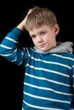 迷茫的年轻男孩 免版税库存图片