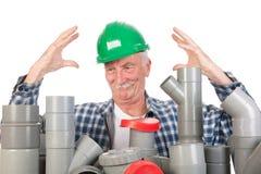 迷茫的滑稽的水管工 库存图片