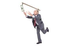 追逐一美元的商人 免版税库存图片