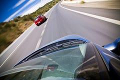 追逐红色的汽车 免版税图库摄影