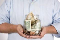 退休人员退休存钱罐帐户 库存照片