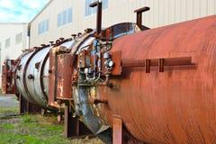 退休的木材磨房设备 免版税库存图片