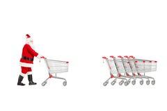 退回一空的shoppin的圣诞老人的全长画象 库存图片