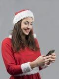 送圣诞节greatings的圣诞老人女孩 库存图片