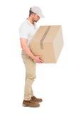 送货人运载的包裹 库存照片