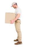 送货人运载的包裹 免版税库存图片