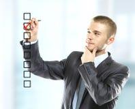 选择三个选择之一的商人 免版税图库摄影