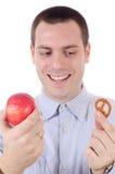 选择人椒盐脆饼红色的苹果 免版税库存图片
