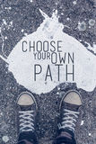 选择您在都市沥青backgro的自己的道路诱导行情 免版税库存照片