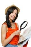选择旅行目的地的新女性 免版税库存照片