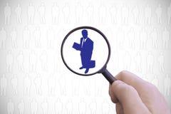 给选择标志雇用职员,正在寻找在候选人中的一个商人 库存图片