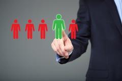选择正确的伙伴的商人从许多候选人 免版税图库摄影