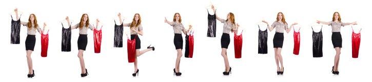 选择礼服的妇女隔绝在白色 库存图片