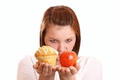 选择饮食女孩少年认为 免版税库存照片