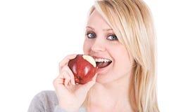 选择:采取苹果计算机的叮咬妇女 免版税库存照片