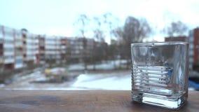 透明水晶玻璃在木站立 免版税库存照片