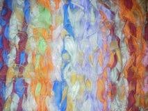 透明硬沙织品呈了杂色背景蓬松毛线粗野的织法明亮的颜色 免版税图库摄影