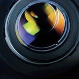透镜和敞篷大详细的宏观徒升特写镜头,五颜六色的玻璃反射 免版税库存图片