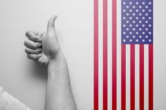 递与美国国旗的赞许好最佳的国家的 库存照片