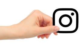 递举行在白色背景隔绝的Instagram象 免版税库存图片