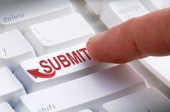 递交键盘按钮网上提议 免版税库存照片