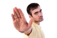 递他的人被上升的信号终止对年轻人 免版税库存照片