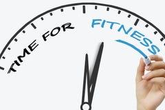 递健身概念的文字时间与在透明抹板的蓝色标志 图库摄影