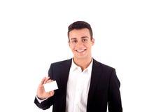 递在白色后面的年轻商人一张空白的名片 库存照片