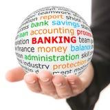 递得与红色题字银行业务的白色球 免版税库存照片