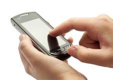 递您的移动电话 免版税库存照片
