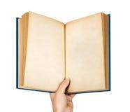递拿着在空的葡萄酒蓝色盖子的一本开放书 免版税库存图片