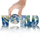 递拿着在题字世界的背景的行星地球 免版税库存图片