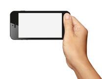 递拿着在水平的黑智能手机在白色 免版税库存照片