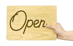 递拿着有开放词的木板材被隔绝在白色背景 免版税库存照片