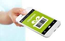 递拿着有春天折扣优惠券的手机在白色 免版税库存照片