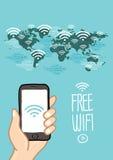 递拿着有自由wi的fi手机在世界地图 免版税库存照片