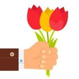 递拿着郁金香,手中的郁金香花束花束  平的设计 库存图片